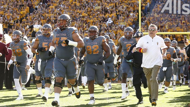 Arizona State head coach Todd Graham and his Sun Devils take the field to play Arizona during the 89th Territorial Cup on Nov. 21, 2015 in Tempe, Ariz.