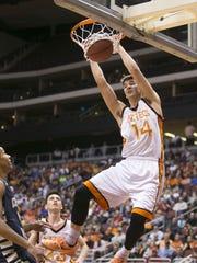 Corona del Sol's Dane Kuiper dunks the ball against