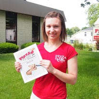 Samantha Roberts, 26, of Fond du Lac, stands in front of PizzaVille, which she recently purchased.