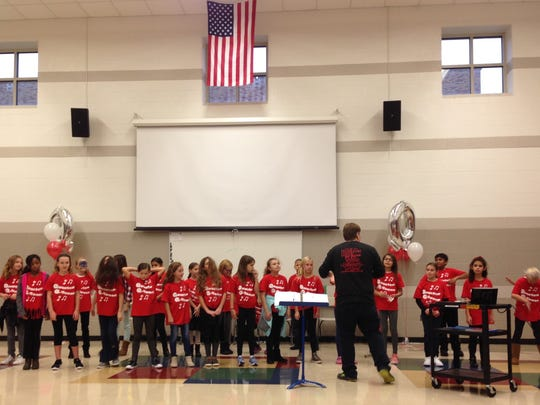 The Quarton Q-tones entertain the visitors with singing under the direction of Al Dubruck, vocal music teacher.