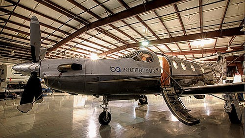 A Boutique Air Pilatus PC-12 prop plane, such as the one pictured is used to service the Cavern City Airport in Carlsbad.
