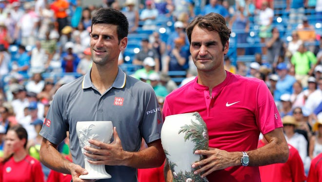 Novak Djokovic (left) stands with Roger Federer (SUI) after their match in the finals during the Western and Southern Open tennis tournament at the Linder Family Tennis Center.