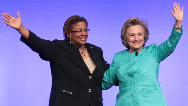 Hillary Rodham Clinton, right, waves with Yvette Richards, president of the United Methodist Women, after the former U.S. secretary of state spoke April 26, 2014, at the United Methodist Women's Assembly.