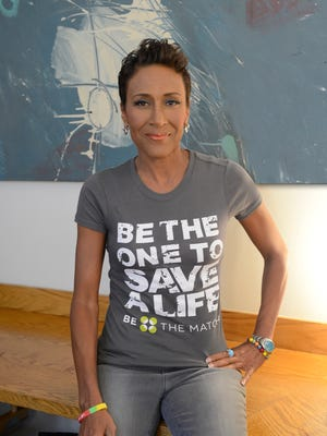 "Robin Roberts, co-anchor for ABC's Good Morning America, tapes a public service announcement for the ""Be the Match"" campaign on the one-year anniversary of her bone marrow transplant in 2013."