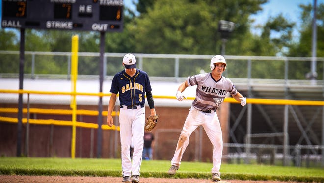 Enthusiastically reaching second base after his RBI double against Saline is Plymouth's Chase Every.