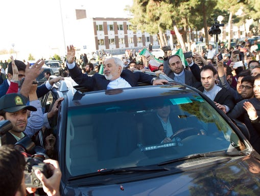 Iranian Foreign Minister Javad Zarif greets supporters
