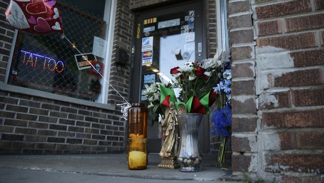 A memorial to police shooting victim Michael L. Funk stands in front of Eagle Nation Cycles.