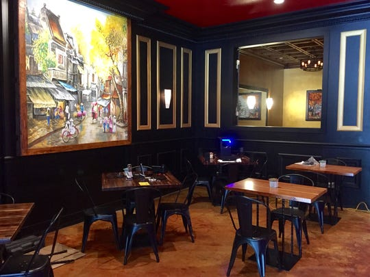 Liam Le, owner of Creazian Vietnamese fusion restaurant, commissioned paintings of Hanoi street scenes for the place.