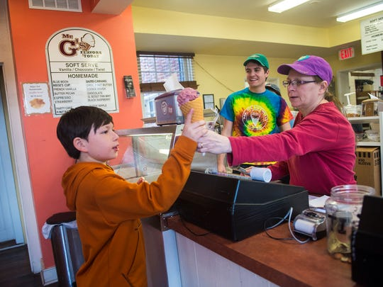 Samuel Blevins, 10, of Berryville, Va., orders an ice cream from employees Donna Ness and Jake Miller at Mr. G's Old Fashioned Ice Cream in Gettysburg.