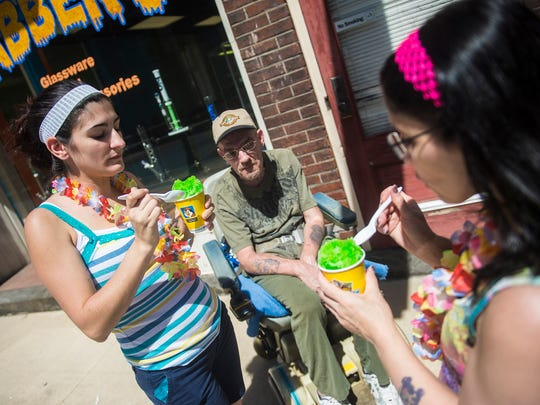 York Street neighbors Amber Ignatius, left, Charles Maddox, center, and Mary James, right, enjoy shaved ice during the warm weather in 2016. New in 2017, Kona Ice now has an additional truck and expanded coverage to include the Adams County, Spring Grove and Abbottstown areas.