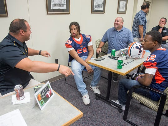 From the left, Red Lion Football coach Jesse Shay,  William Penn player Marcus Mitchell, William Penn coach Russ Stoner and William Penn player Duvel Wilson chat  during High School Football Media Day at the York Daily Record/ Sunday News.