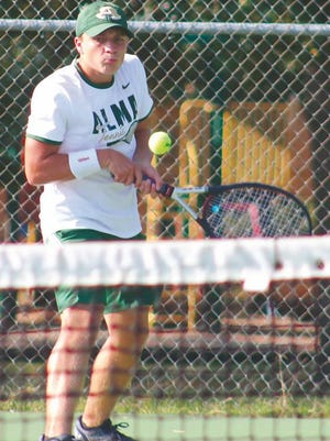 Alma's Blake Williams returns a serve at Creekmore Park during a nonconference match with Northside's JV team on Monday in Fort Smith.