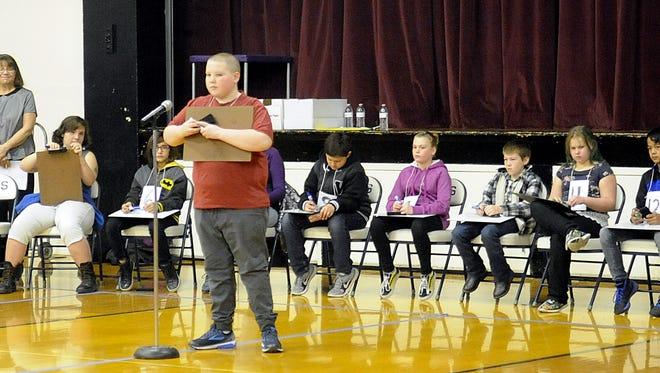 Dayton Intermediate School seventh-grader Morgan Bumgardner spells a word during the competition.