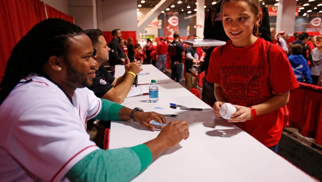 Payton Wilson, 10, of Loveland gets an autograph from Johnny Cueto at 2013 Redsfest.