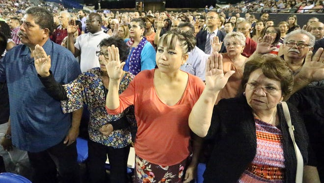 Nearly 1,000 immigrants became U.S. citizens at a ceremony put on by the U.S. Department of Homeland Securityon Wednesday atthe El Paso County Coliseum.