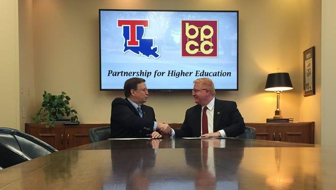 Louisiana Tech President Les Guice (left) and BPCC Chancellor Rick Bateman, Jr. officially sign program agreement on Thursday.