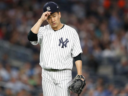 New York Yankees starting pitcher Masahiro Tanaka returns to the dugout after pitching during the third inning of the team's baseball game against the Boston Red Sox in New York, Wednesday, May 9, 2018.