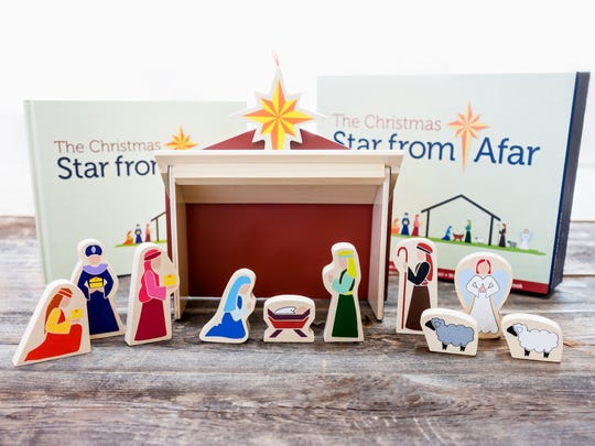 A storybook and Nativity teaches children about Advent and Christmas.
