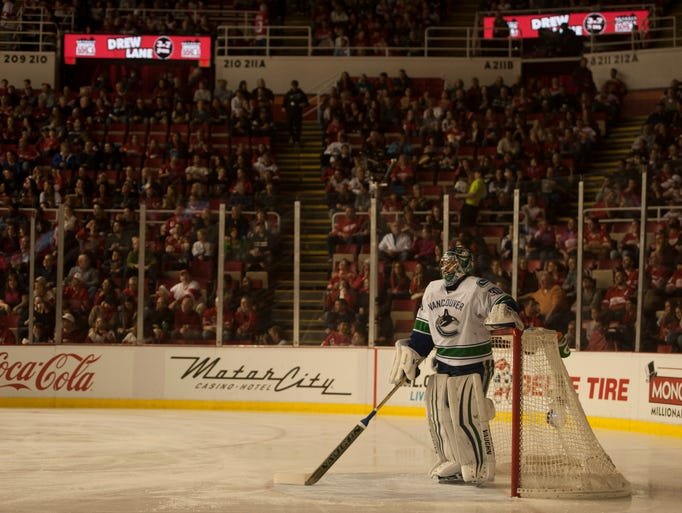 Vancouver goalie Ryan Miller stands in the dark after