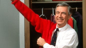 """Fred Rogers, the host of """"Mister Rogers' Neighborhood,"""" gets ready for work in this 1995 photo."""