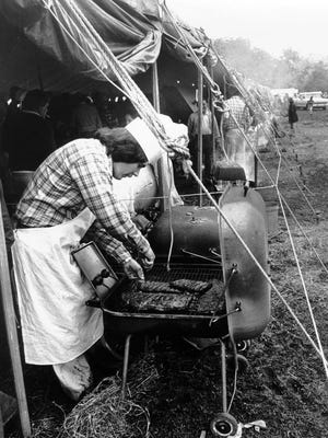Bill Hopper of 2831 Toehill works on his ribs during Memphis In May International Festival's  second annual World Championship Barbecue Cooking Contest on 5 May 1979.  This was the first contest held in Tom Lee Park (the small version of the park before the expansion in 1971) and all contestants cooked under one huge tent.