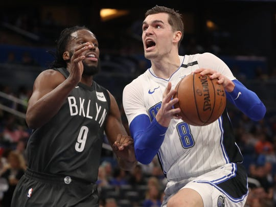Orlando Magic wing Mario Hezonja drives to the basket against Brooklyn Nets wing DeMarre Carroll at Amway Center on March 28, 2018 in Orlando.
