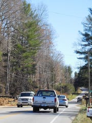 Traffic is seen looking southeast down Mills Gap Road at midday Monday.