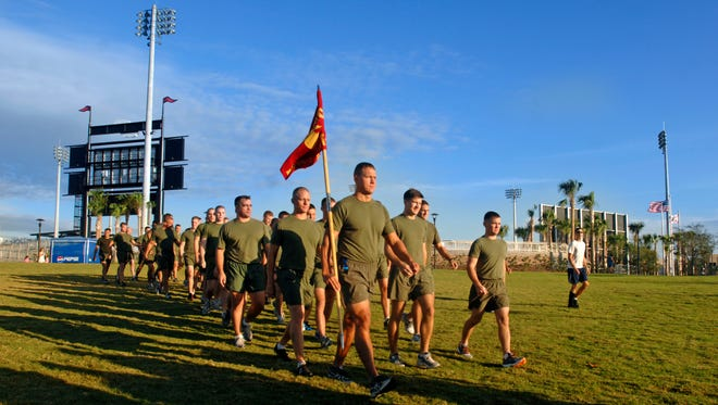 Marines make their way to the starting line during the Semper Fi 5K charity run in 2012.