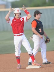 Baird's Jax Bellar, left, celebrates after hitting