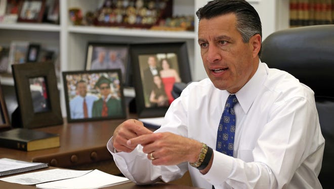 AP  Gov. Brian Sandoval wants an expedited hearing in the  private-school program suit. Nevada Gov. Brian Sandoval sits in his office at the Capitol in Carson City.