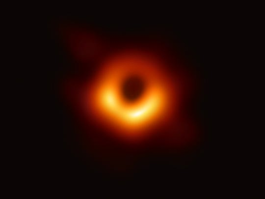 The Event Horizon Telescope captures a black hole at the center of galaxy M87, outlined by emissions from hot gas swirling around it under the influence of super-strong gravity.