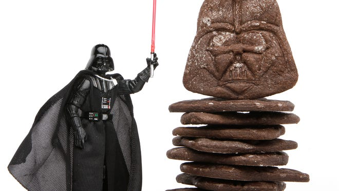 Celebrate Star Wars Day with dark chocolate Darth Vader cookies.