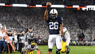 Penn State Nittany Lions running back Saquon Barkley (26) reacts to his touchdown run against the Michigan Wolverines during the first quarter at Beaver Stadium.