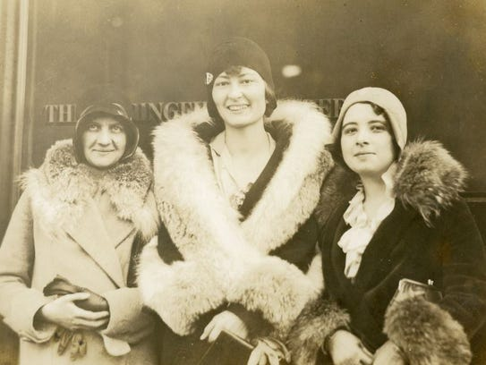 This photo was taken in the 1920s, outside the newspaper office in Springfield. Lucile Morris Upton, who was 5 foot 9, is in the center. She is with two other reporters. On the left is Helen Laverty, who used the pen name Dorcia Harrell.  The woman on the left is Beth; her last name appears to be Campbell.