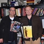 Ryan Hurn (right), drummer with The Texas Tenors, donated more than 80 books and periodicals to the Evangel University music library this spring. Evangel's director of jazz studies, Joel Griffin, is cataloging the collection.