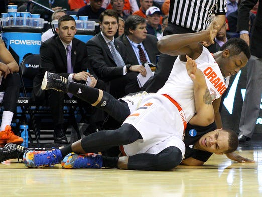 Syracuse's Jerami Grant (3) and Western Michigan's David Brown (5) roll on the floor for a loose ball during their NCAA game March 20 in Buffalo.