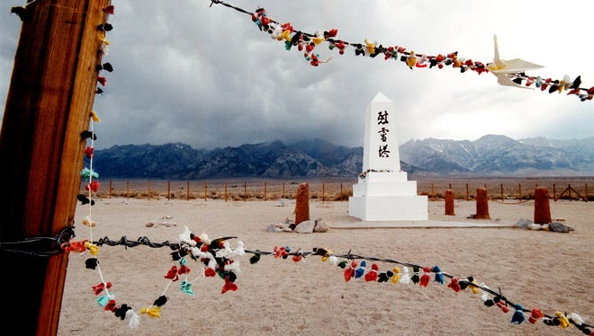 Offerings hang on the barded wire fence surrounding the cemetery of the former Manzanar War Relocation Center, which is south of Independence, Calif.