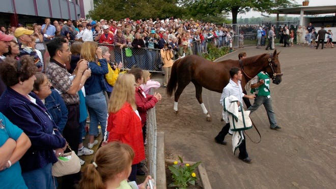 Funny Cide is walked out to the paddock before the 31st Wadsworth Memorial Handicap in 2007.