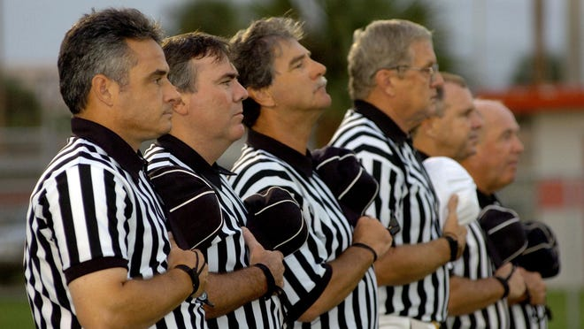Gannett LouisianaThe reason? The LPA rejected a plan to increase the pay for local high school football officials by $5 per game. For a standard six-man crew, that works out to an extra $30 per game. 09/09/05 - Satellite, Fla. - Photo by Christina Stuart - Florida High School Athletic Association football referees Greg England, left, Warren Kugelmann and others address the flag and the national anthem played before the Satellite High School game against Space Coast High School at Satellite High School Friday, September 9, 2005.archived by cstidham
