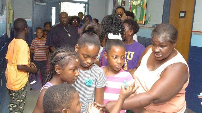 Grandparents, parents and school-age children arrived to pick up donated school supplies Saturday at the Opelousas Boys and Girls Club. See a photo gallery at dailyworld.com and of Facebook.