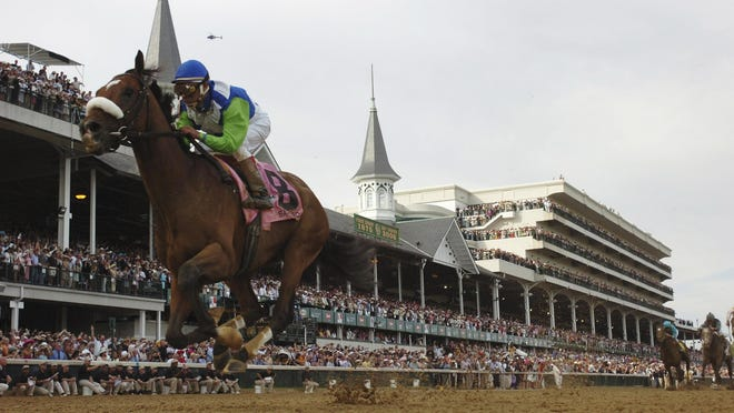 Barbaro crosses the finish line to win the Kentucky Derby on May 6, 2006.