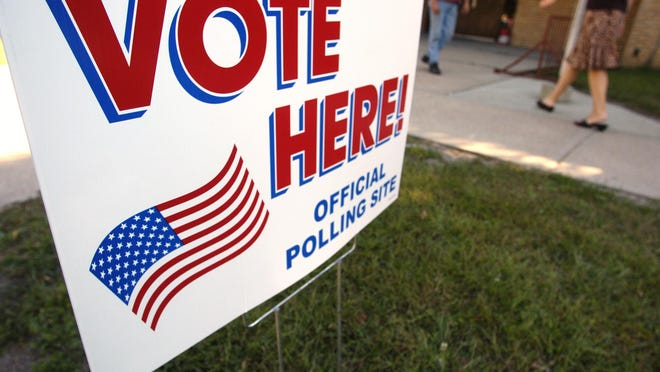 A sign lets voters know where to vote in front of the elementary school in Dell Rapids. (Lara Neel/Argus Leader)