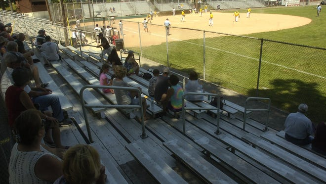 Shade and social distancing were necessary during the USA Softball 50 and over tournament games at Brookside Main Field Saturday.