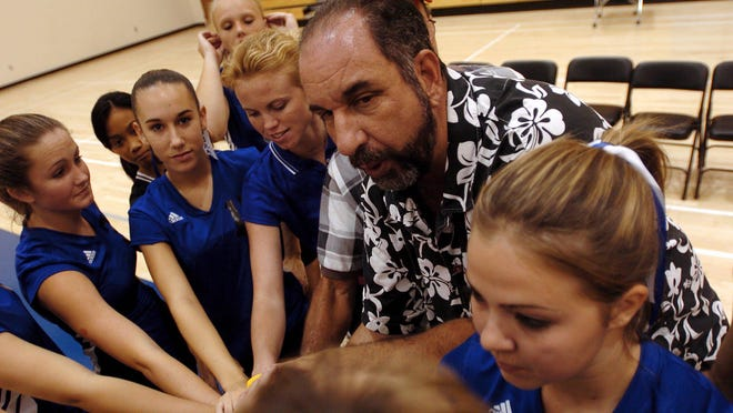 In this 2004 photo, Park Vista girls volleyball coach Ira Hubschman gathers his team together during a break in the action at South Fork High School. Hubschman's final season as a coach was cut short this spring due to the coronavirus pandemic as the season came to an abrupt end for Park Vista boys volleyball.
