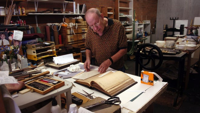 Bookbinder John Ravenhill died at age 77.