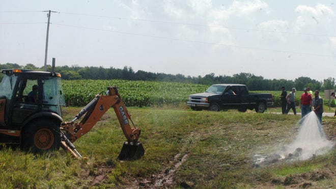 Manure spill clean-up on County D and Wisconsin 54 in the aftermath of a tanker crash Thursday morning.