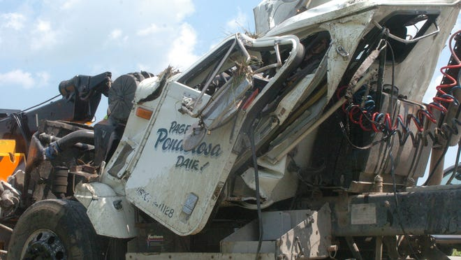 The driver of a manure tanker that crashed early Thursday walked away from the crash with minor injuries and was taken to the hospital to check for further problems.