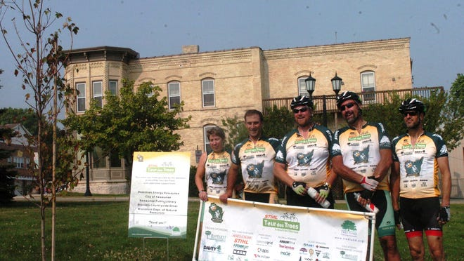 Kristin Wild, Warren Hoselton, Aaron Dickinson, Frazer Pehmoeller and Christian Siewert, cyclists from across the country, stopped at Harbor Park in Kewaunee on Aug. 1 as part of the STHIL Tour des Trees ride to plant a maple tree. The ride is raising funds for tree research and education.