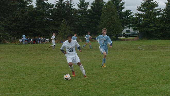 Algoma freshman Eric Arvizu works towards the St. Mary goal during the Wolves' home game Sept. 29.