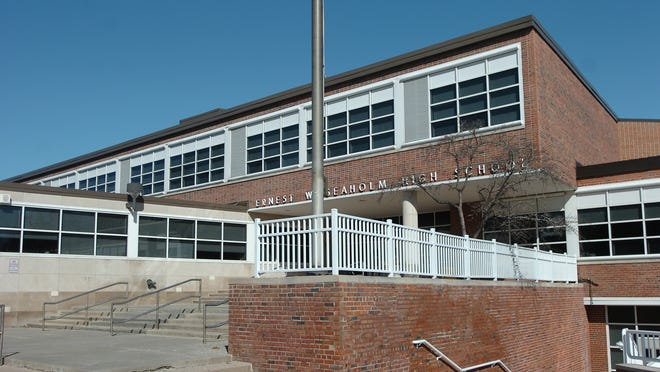 A parent has been banned from the grounds at Seaholm High School after allegedly striking a teacher.